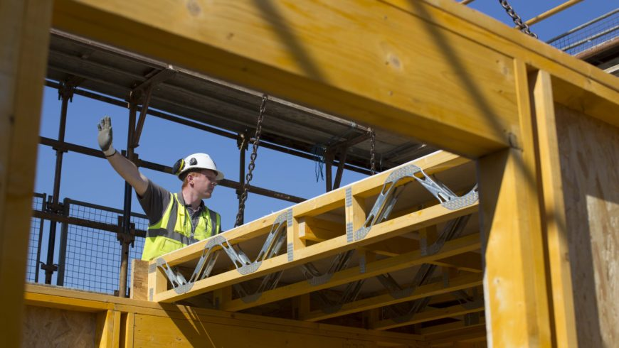 How can construction improve its productivity?