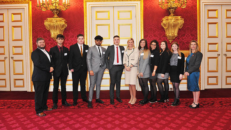 Duke of York presents awards to two Redrow apprentices