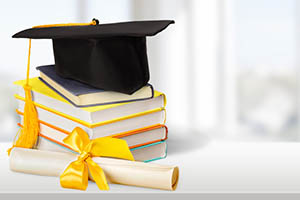 Mortar board and books