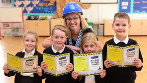 Jennifer of David Wilson Homes with pupils of Langford Village Academy